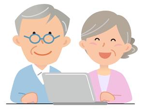 パソコン操作をする夫婦